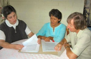 Sisters Carmen Maldonado, Rebeca Duque and Anne Marie Smith plan together in their community in Santiago, Chile.