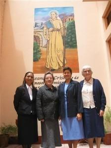 Sisters Gloria Santos (Peru) , Anne Ryan, Anne Carbon and Kathleen Mary Riordan (Chile) before the fresco of St Columban