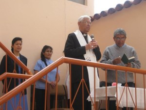 Archbishop Luis Sabastiani Aguirre pronouncing the blessing, along with Sister Anne Carbon and a member of staff