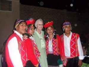 The colourfully clad Peruvian Dance group pose with Bridie for a souvenir photo