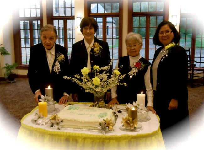The Jubilarians have their special moment:Sister Rose (the Korea Mission), Sister Corona, long term Administrator of St Columbans-on-the-Lake, Sister Anna (US Mission) and Sister Virgie (Pakistan & Chile) now Area Coordinator of US Area