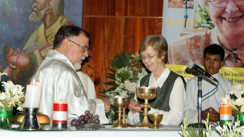 Sister Ana Maria receives communion from Msgr. Lino Panizza