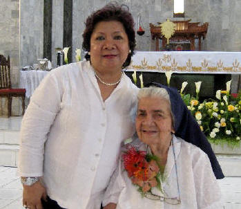 Sister Regina with Lourdes de Guzman, a former student from Lingayen - which was Sister Regina's  first mission assignment.